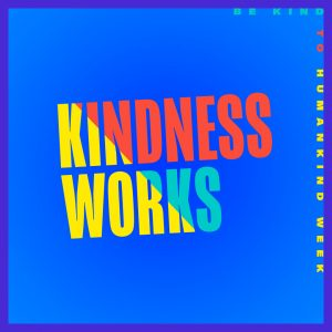 """The words """"KINDNESS WORKS"""" are in the center in a narrow, all capital, sans-serif font, and Cadmium yellow, Jasper, and Dark turquoise. The words """"BE KIND TO HUMANKIND WEEK"""" are on the top and right edge of the image in a smaller, wide, all capital, sans-serif font. They are also a mix of the same colors. The background color is Brandeis blue with a Han purple border."""